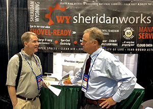 Sheridan, Wyoming Mayor Dave Kinskey speaking with Chuck Hobart at Data Center World.